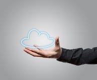 Man holding a cloud symbol Royalty Free Stock Photos