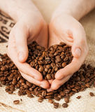 Man holding coffee beans Royalty Free Stock Photos