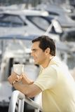 Man holding coffee cup Royalty Free Stock Images