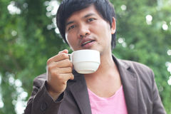 Man holding coffee cup Stock Images