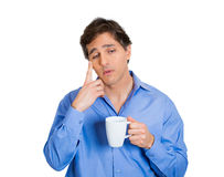 Man holding coffee and thinking Royalty Free Stock Photography