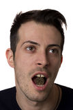 Man holding a coin in the mouth Stock Image