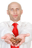Man holding coins. A man holding a handful of coins royalty free stock image
