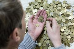 The man is holding coins. stock image