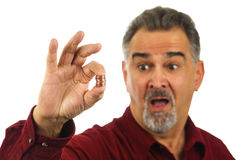 Man holding coins with look of shock on his face Royalty Free Stock Photos