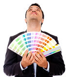 Man holding a color guide Royalty Free Stock Image