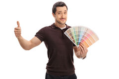 Man holding color swatch and making thumb up sign Stock Photos