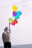 Man holding colorful balloons Royalty Free Stock Photo