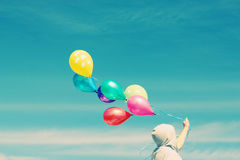 Man holding colorful balloons Stock Photo
