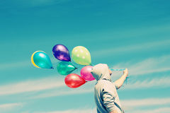 Man holding colorful balloons Royalty Free Stock Photography