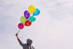 Man holding colorful balloons Royalty Free Stock Photos