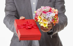 Man holding colorful bouquet of freesia flowers Stock Images