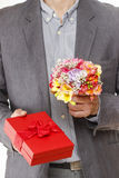Man holding colorful bouquet of freesia flowers Stock Image