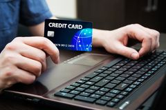 Man holding colorful credit card Royalty Free Stock Images