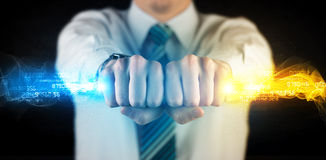 Man holding colorful glowing data in his hands Stock Images