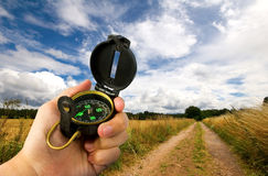 Man holding compass in field Royalty Free Stock Photography