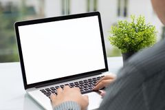Man holding computer with isolated screen in cafe Royalty Free Stock Photo