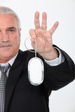 Man holding computer mouse Royalty Free Stock Images