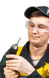 Man holding a cordless screwdriver Royalty Free Stock Images