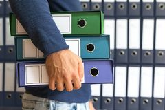 Man holding, corporate files in document binder. Conceptual Business Stock Image