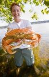 Man holding crab Stock Photo