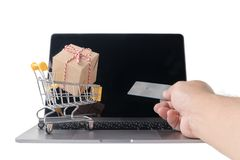 Man holding credit card    and Boxes in a trolley royalty free stock photography