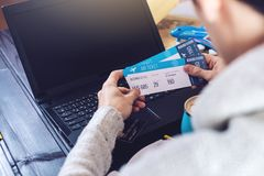 Man holding credit card and buys plane tickets on Internet Royalty Free Stock Photography