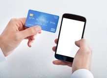 Man Holding Credit Card And Cell Phone Stock Photos