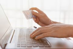 Man holding credit card close up, e commerce, online trading, cr. Edit card payment concept, vintage style Stock Photo