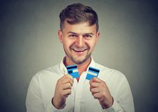 Excited man done with credit cards stock photo