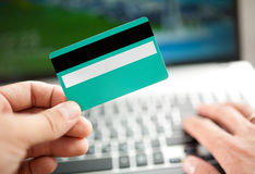 Man holding credit card in hand Royalty Free Stock Images