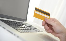 Man holding credit card in hand online shopping and banking. With computer Royalty Free Stock Photography