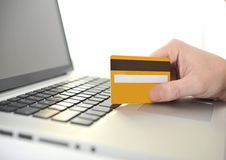 Man holding credit card in hand online shopping and banking. With computer Royalty Free Stock Photo