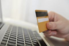 Man holding credit card in hand online shopping and banking. With computer Royalty Free Stock Photos