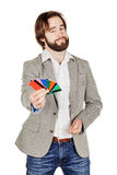 Man holding a credit card isolated on white background Stock Image