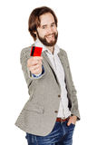 Man holding a credit card isolated on white background Royalty Free Stock Images