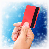 Man holding a credit card on New Year's background Stock Photos