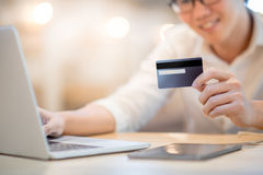Man holding credit card for online shopping Stock Photography