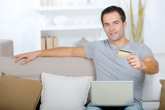 Man holding credit card online shopping Stock Photo