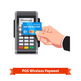 Man holding credit card paying over POS terminal. Man holding credit card in hand paying wirelessly over POS terminal. Flat vector icon vector illustration