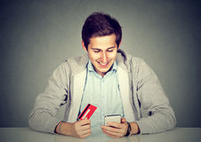 Man holding credit card smart phone for internet shopping Stock Image