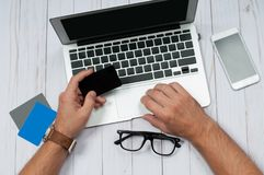 Man holding credit card and using laptop computer. Online Shopping Concept Stock Photography