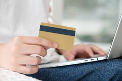 Man holding credit card and using laptop computer to shopping on. Line, business and technology concept, digital marketing, casual lifestyle Stock Photography