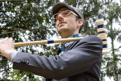 Man holding croquet mallet Royalty Free Stock Image