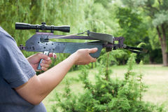 Man holding a crossbow. Man holding a black crossbow Royalty Free Stock Images