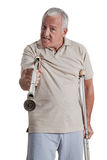 Man Holding Crutch Like a Weapon Royalty Free Stock Photos