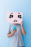 Man holding cry expression billboard royalty free stock photos