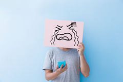 Man holding cry expression billboard Royalty Free Stock Photo