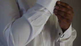 Man holding cuffs stock footage