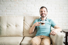 Home alone drinking cappuccino Royalty Free Stock Photo